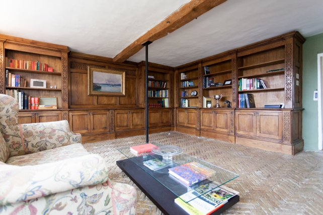 Bookcase library with secret door.  Lower cupboards having doors to hide media equipment