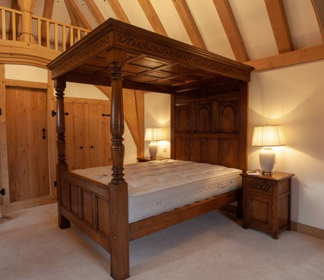 4 poster bed with carving