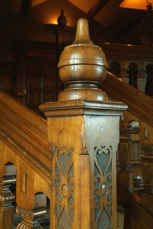 finial and hand carved newel post detailing