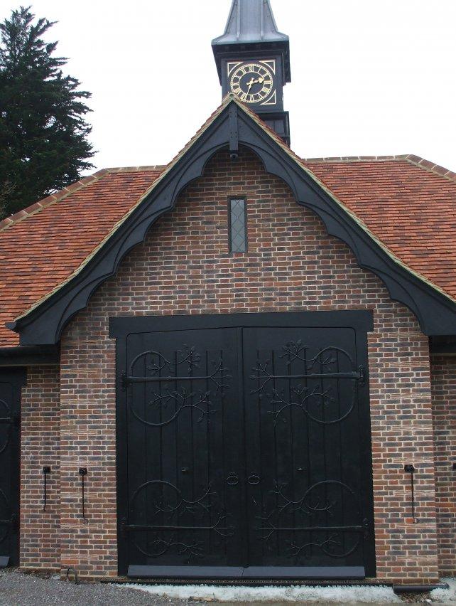 large bespoke garage doors with handmade ornate ironwork