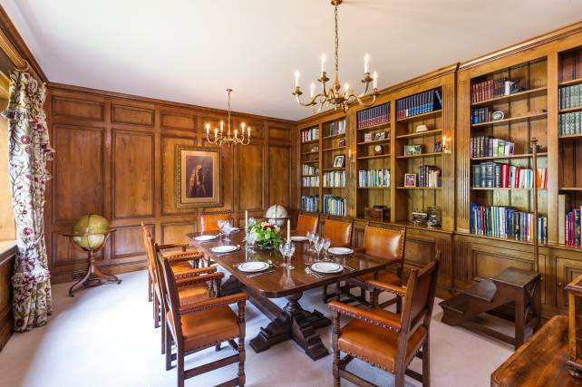 18th century panelling and bookcases in a study/dining room